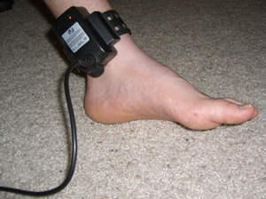 GPS tracking device on ankle of 13-year-old boy